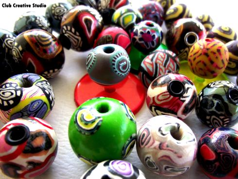 Collection of Club Creative Studio hand-rolled clay beads.