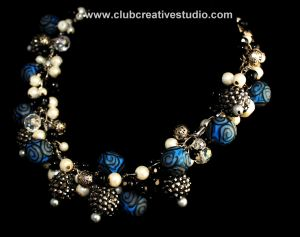 Hand-made jewelry art with a focus on the color blue.