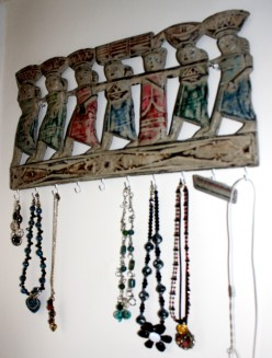 Finished art transformed in to a display jewelry hanger.